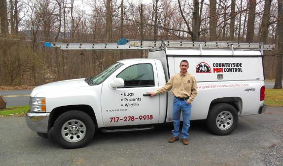Joel with his Countryside Pest Control truck.